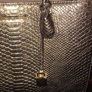 Michael Kors Bags - Beautiful gold snake embossed MK 1 day sale